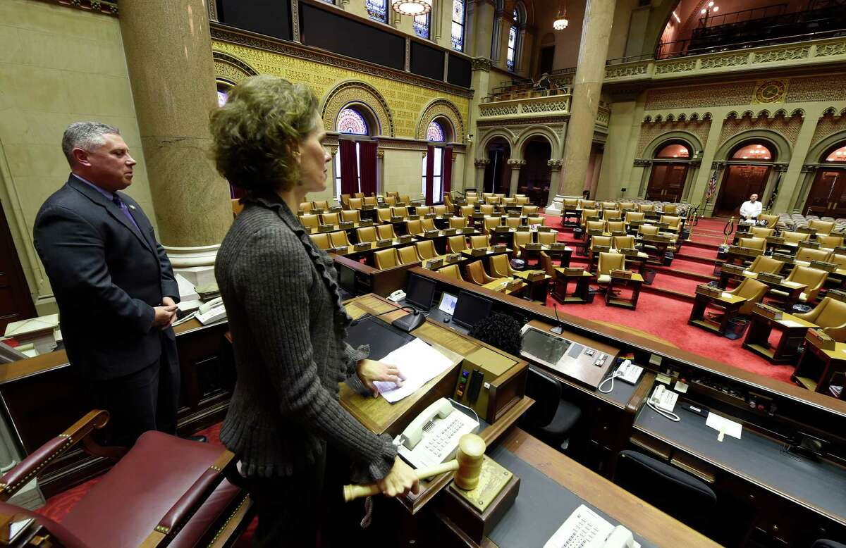 Assemblywoman Patricia Fahy gavels in session Monday, Dec. 1, 2014, in Albany, N.Y. With Fahy is Assemblyman John McDonald who is also charged with gaveling in the empty chamber on alternative dates to Fahey. (Skip Dickstein/Times Union)