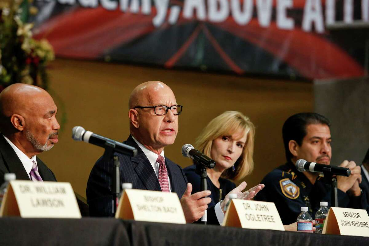 Democratic Sen. John Whitmire, center, leads a discussion with Pastor John Ogletree, from left, District Attorney Devon Anderson, Sheriff Adrian Garcia and other panelists at a town hall meeting held at The Community of Faith Church in north Houston on Monday.