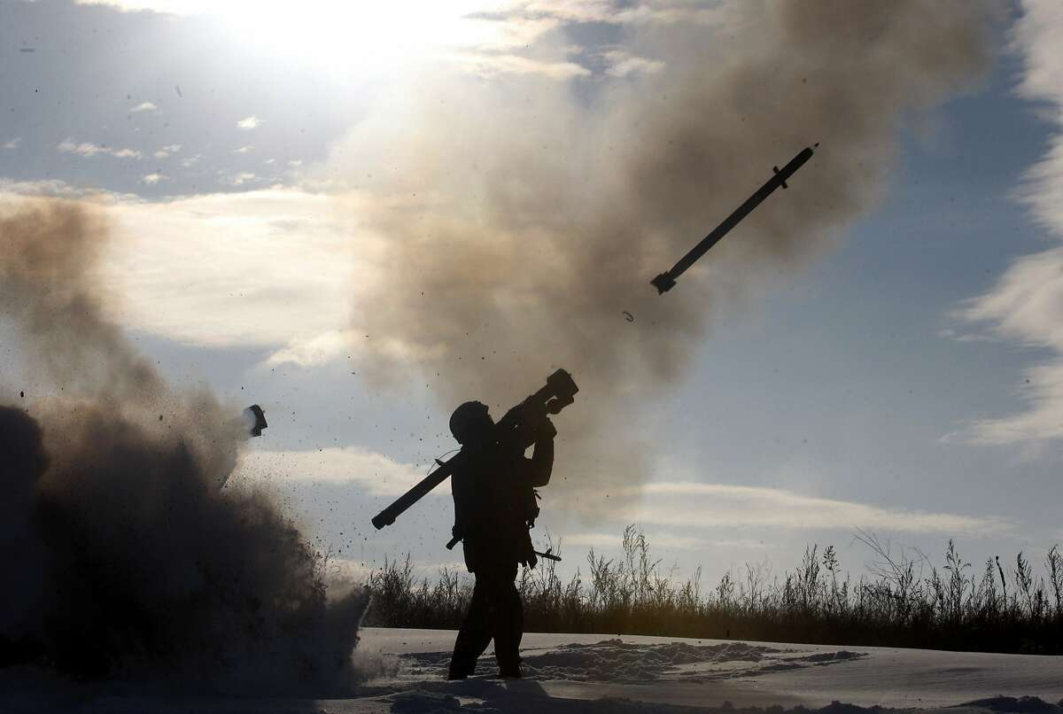 TOPSHOTS A Ukrainian soldiers fires a missile with a man-portable air-defense system during exercices near the city of Shchastya, north of Lugansk, on December 1, 2014. At least three Ukrainian soldiers have been killed and 14 injured in the past 24 hours as fighting intensifies for control of Donetsk airport, a military spokesman said on December 1, 2014. AFP PHOTO/ ANATOLII STEPANOVANATOLII STEPANOV/AFP/Getty Images