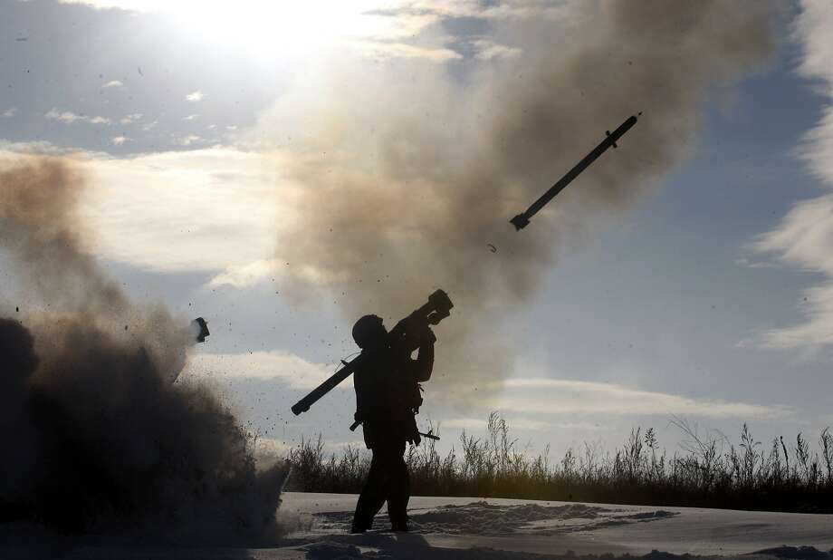 TOPSHOTS A Ukrainian soldiers fires a missile with a man-portable air-defense system during exercices near the city of Shchastya, north of Lugansk, on December 1, 2014.  At least three Ukrainian soldiers have been killed and 14 injured in the past 24 hours as fighting intensifies for control of Donetsk airport, a military spokesman said on December 1, 2014. AFP PHOTO/ ANATOLII STEPANOVANATOLII STEPANOV/AFP/Getty Images Photo: Anatolii Stepanov, AFP/Getty Images