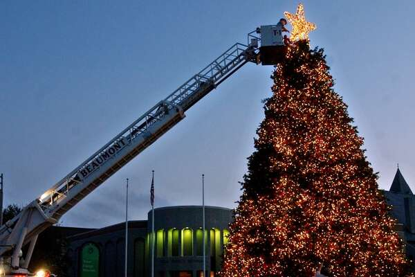 Beaumont firefighters officially light a Christmas tree at the Art Museum of Southeast Texas before the Winter Wonderland Christmas Holiday Parade in Beaumont on Saturday, Dec. 3, 2005. (AP Photo/The Beaumont Enterprise, Mark M. Hancock)