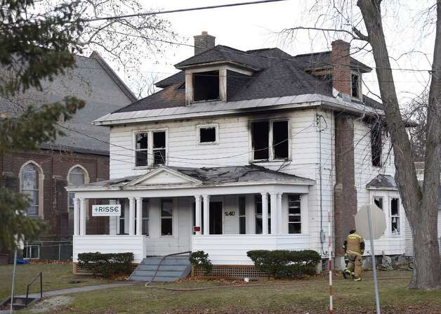 A fire that has been labeled suspicious gutted the offices of at the offices of Refugee and Immigrant Support Services of Emmaus (RISSE) early Tuesday morning, Dec. 2, 2014, at 240 W. Lawrence in Albany, N.Y. Investigators discovered slashed tires on two company vehicles parked next to the building. (Skip Dickstein/Times Union)