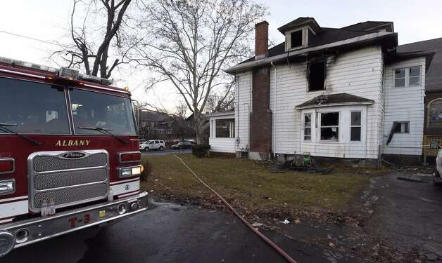 Firefighters remained at the scene Tuesday of an early morning fire that damaged a building on West Lawrence Street. The fire at 240 W. Lawrence St., was first noticed at about 5 a.m. (Skip Dickstein / Times Union)
