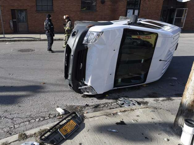 City police are investigating a rollover crash at the intersection of Weaver Street and Broadway. The crash occurred shortly before 11 a.m. (Skip Dickstein / Times Union)