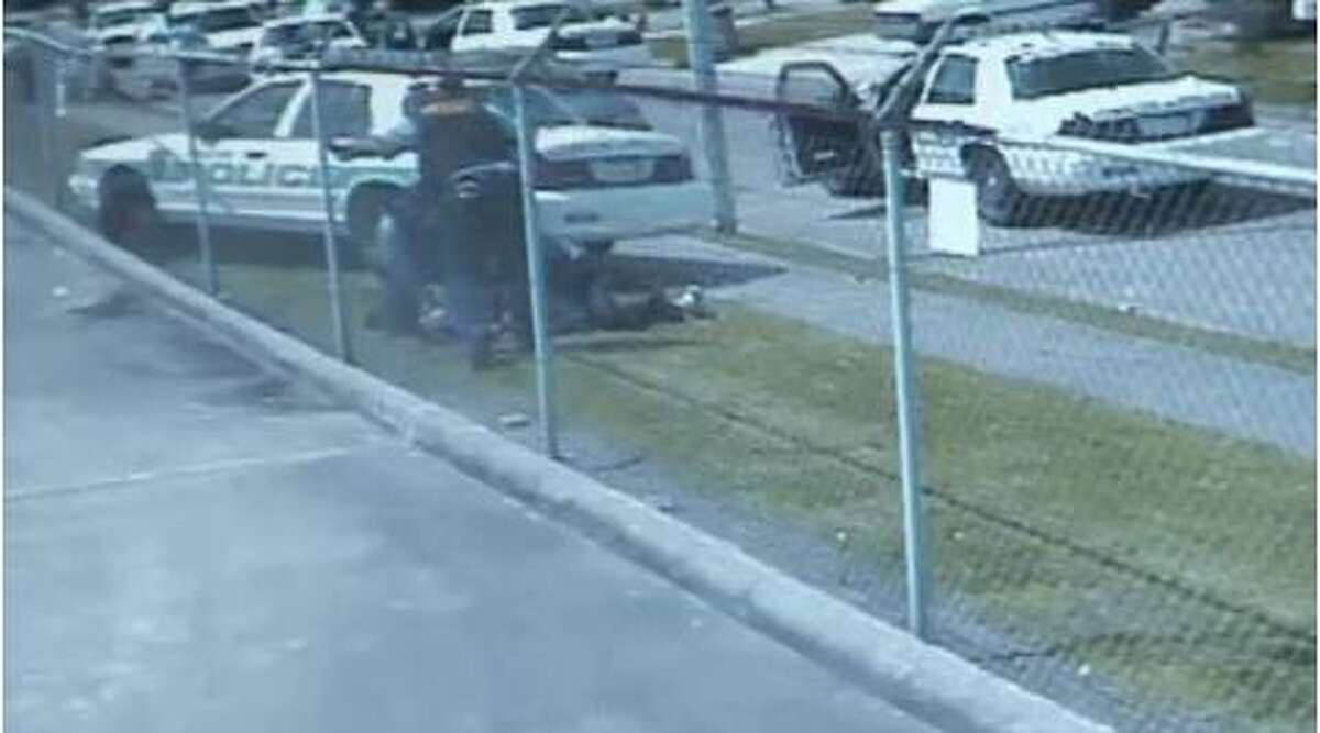 A store surveillance camera captures members of the Houston Police Department striking Houston teen Chad Holley with a patrol car and then beating him.