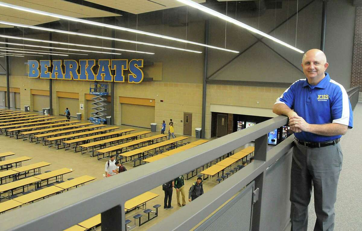 Principal Larry Whitehead overlooks the renovated Klein High School campus. Crews are putting the finishing touches on the $123 million renovation.