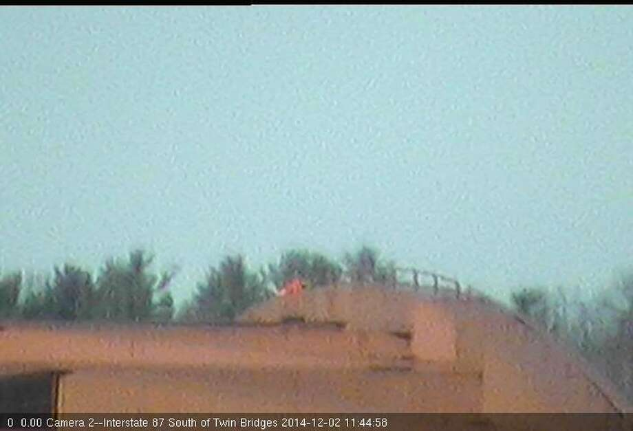 A man can be seen walking atop the Twin Bridges that carry the Northway over the Mohawk River in Latham in a screen grab from a state DOT web cam shortly before noon Tuesday. State Police are investigating whether the man is a construction worker or an unauthorized person.