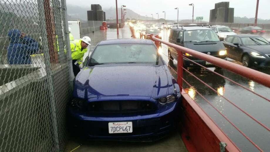 A drunken driving suspect's car is wedged in the pedestrian walkway of the Golden Gate Bridge early this month after investigators say he took a wrong turn. Photo: Golden Gate Bridge District / ONLINE_YES