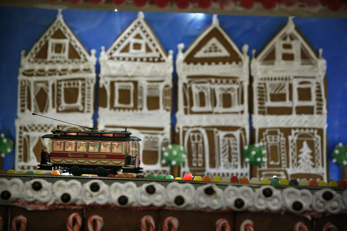 A train moves past a San Francisco landscape made of gingerbread and royal icing at the Palace Hotel on Monday, December 1, 2014 in San Francisco, Calif.