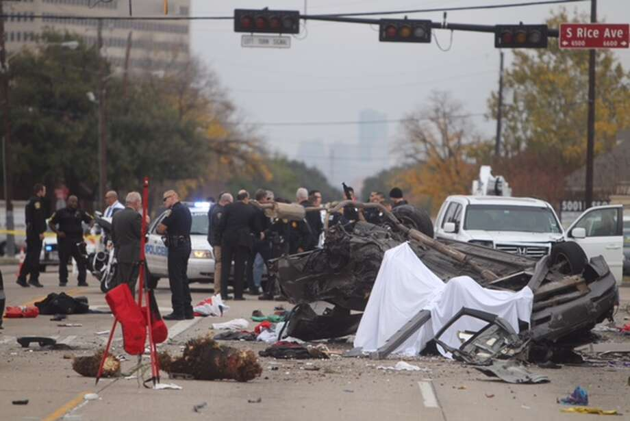 One person is dead after a car crashed into a Bellaire Starbucks on Tuesday, Dec. 2. A suspect had led police on a chase before the crash.  Photo: Cody Duty / Houston Chronicle