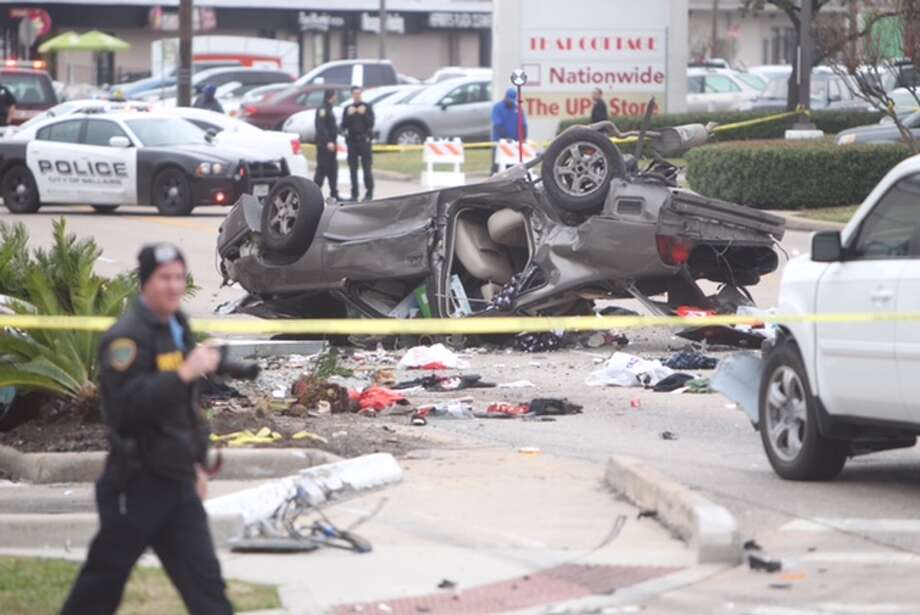 One person reportedly died after a car crashed into a Houston Starbucks, Tuesday, Dec. 2, 2014. Photo: Cody Duty/Houston Chronicle