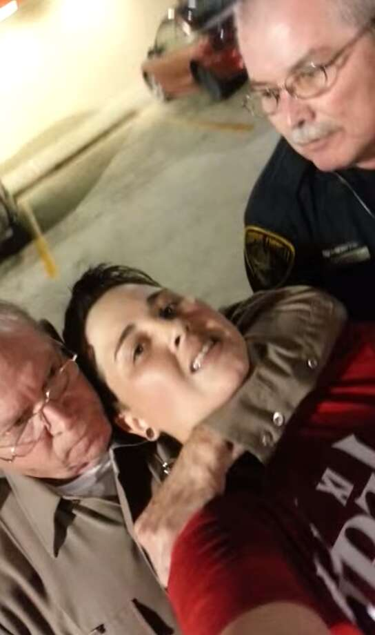"A video uploaded by Lanessa Espinosa on YouTube shows officers placing her in a choke hold. Corpus Christi Senior Officer Jerry Lockhart and an off-duty officer for the Nueces County Attorney's Office detaining her for ""Interference with Public Duties,"" after she did not show an ID and recorded the officers. Photo: YouTube/Screenshots"