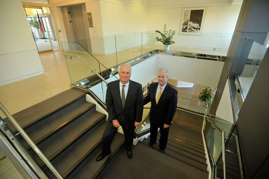 Marc Lautenbach, left, president and CEO of Pitney Bowes and Michael Monahan, chief financial officer, are photographed in their headquarters in Stamford in this file photo from May 2013. The company's shares have staged a comeback since Lautenbach took the helm in 2012. Photo: Jason Rearick / Stamford Advocate