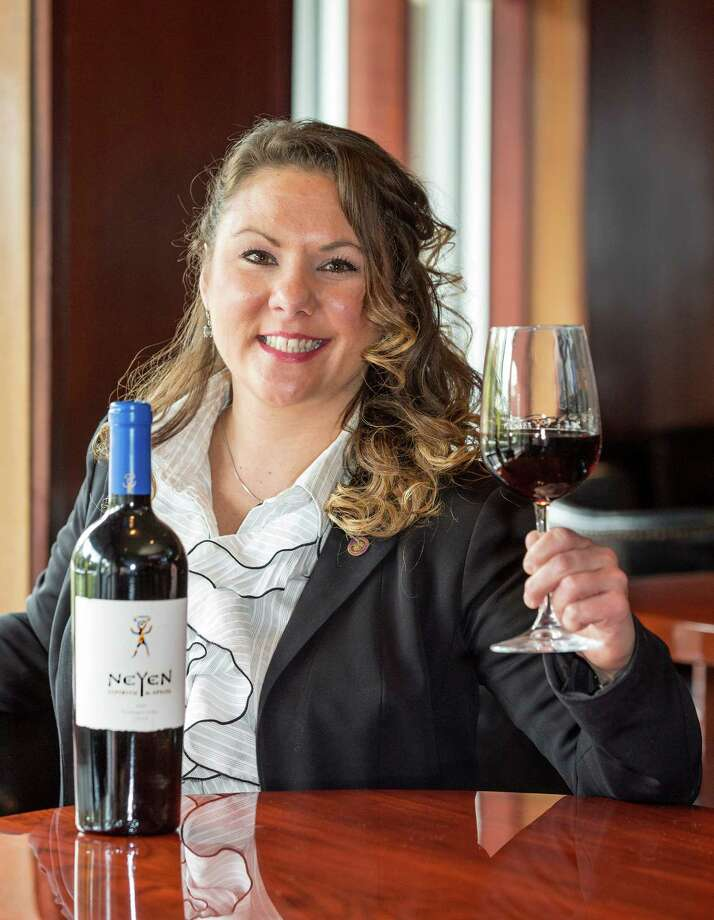 Kristie M. Farmer, Asst. Manager and wine director, Sullivan's Steakhouse, 4608 Westheimer Road, with a bottle of her Neyem wine.  Wednesday  November 19, 2014 (Craig H. Hartley/For the Chronicle) Photo: Craig Hartley, Freelance / Copyright: Craig H. Hartley