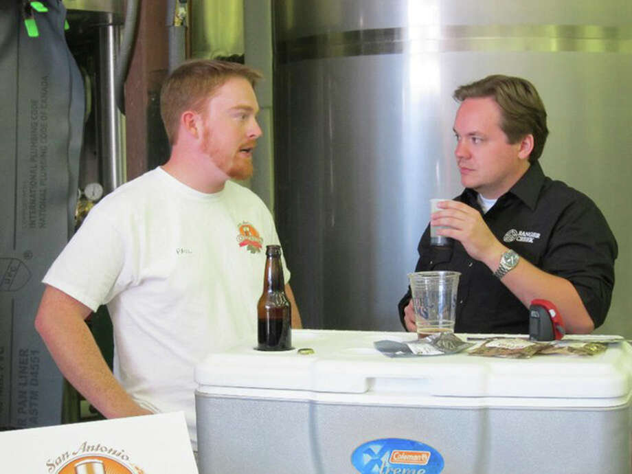 Mark McDavid, right, of Ranger Creek Brewing & Distilling says the company is passionate about beer and whiskey.