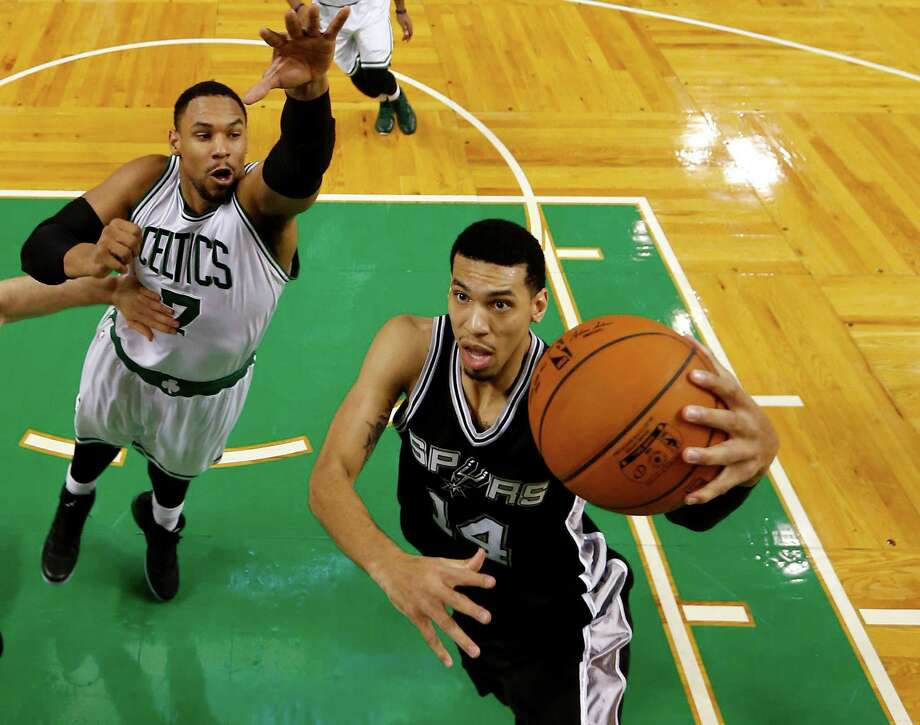 The Spurs' Danny Green drives past the Boston Celtics' Jared Sullinger during the second half of San Antonio's 111-89 win in Boston on Nov. 30. Photo: Winslow Townson, FRE / Associated Press / FR170221 AP