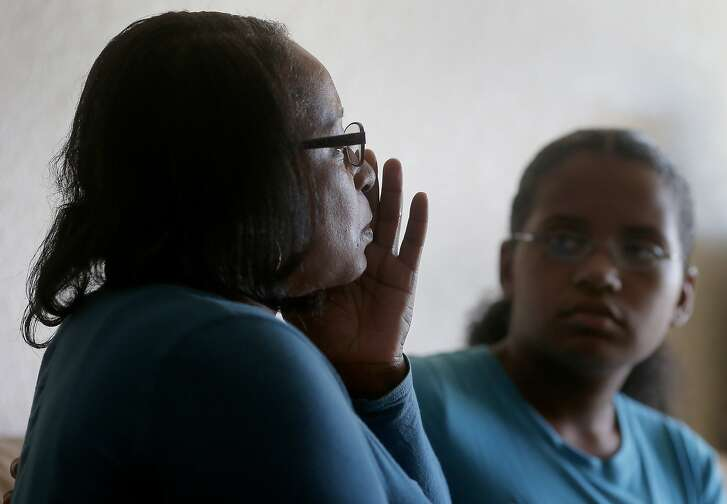 Nichelle Lacy (left) becomes emotional as she talks about her mother who is ill Monday November 24, 2014. Nichelle Lacy is thankful for Season of Sharing for helping her with the apartment rent after losing her job recently. She lives in Hayward, Calif. with her daughter Amani.