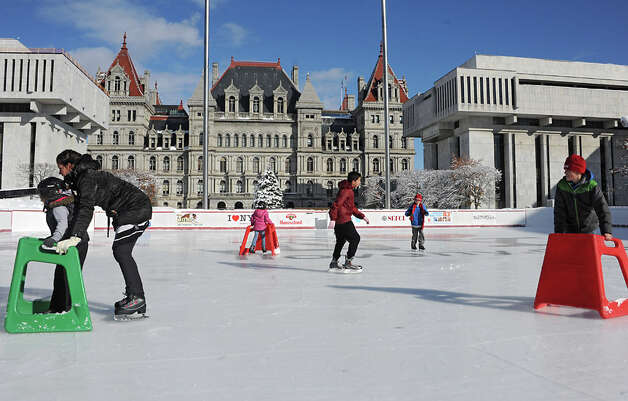 Skaters enjoy opening day of the ice rink located on the Empire State Plaza on Friday, Nov. 28, 2014 in Albany, N.Y. The rink will be open 7 days a week from 11:00 am - 8:00 pm and skating is free. Hannaford sponsors free skate rental on Fridays. (Lori Van Buren / Times Union) Photo: Lori Van Buren, Albany Times Union / 00029292A