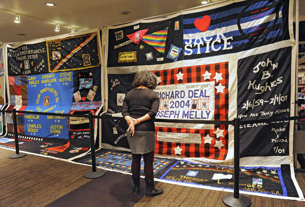 Wendy Milligan of Albany looks at the AIDS Memorial Quilt displayed by The NAMES Project Foundation in the Convention Center on World AIDS Day at the Empire State Plaza on Monday, Nov. 1, 2014 in Albany, N.Y. (Lori Van Buren / Times Union) Photo: Lori Van Buren, Albany Times Union / 00029677A
