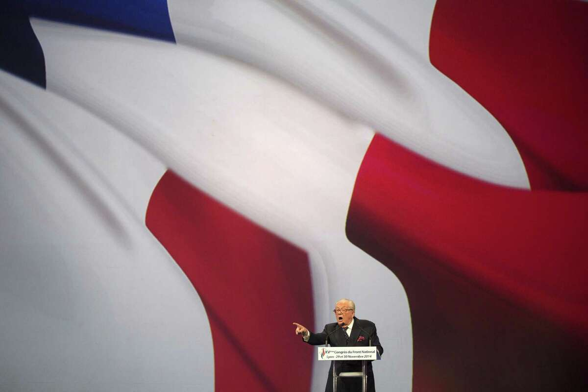 French far-right National Front former leader Jean-Marie Le Pen delivers a speech during the 15th congress of the party, in Lyon, France on Saturday. The 86-year old Jean-Marie Le Pen, now honorary president of the party led by his daughter Marine Le Pen, displays a unified front for the party, but Jean-Marie Le Pen is rankled over the prospect that the party may change its name and other issues need settling before Maine can aim for her dream job as president of France in 2017. (AP Photo/Laurent Cipriani, FILE)
