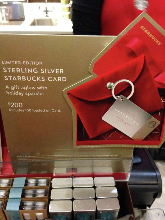 The display for Sterling Silver gift cards at the Starbucks location on Greenwich Avenue in Greenwich, Conn. Photo: Neil Vigdor / Greenwich Time
