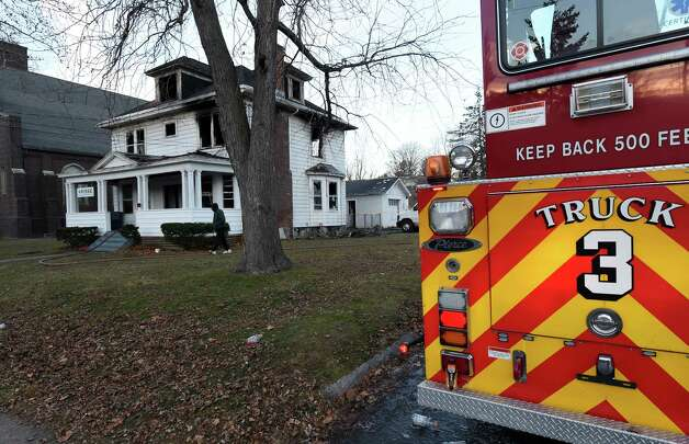 A fire that has been labeled suspicious gutted the offices of at the offices of Refugee and Immigrant Support Services of Emmaus (RISSE) early Tuesday morning, Dec. 2, 2014, at 240 W. Lawrence in Albany, N.Y. Investigators discovered slashed tires on two company vehicles parked next to the building. (Skip Dickstein/Times Union) Photo: SKIP DICKSTEIN