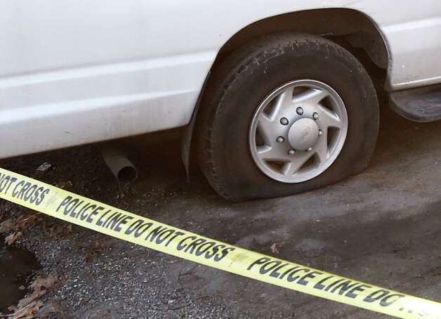Tires of company vehicles were flattened at the scene of a fire at the offices of Refugee and Immigrant Support Services of Emmaus (RISSE) early Tuesday morning, Dec. 2, 2014, at 240 W. Lawrence in Albany, N.Y. The fire has been labeled suspicious. Investigators discovered the damaged tires a short time after firefighters arrived at 5 a.m. at the organization?s 240 W. Lawrence St. building to battle heavy fire coming from the upper floors and attic, officials said.  (Skip Dickstein/Times Union) Photo: SKIP DICKSTEIN