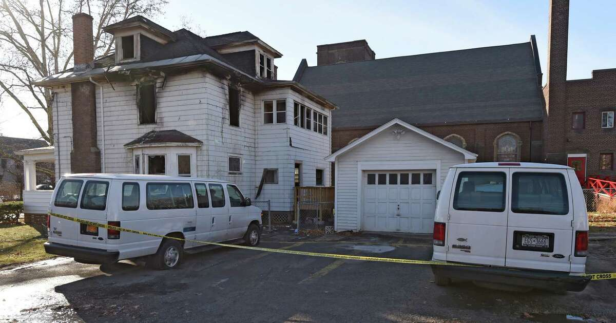 Tires of company vehicles were flattened at the scene of a fire at the offices of Refugee and Immigrant Support Services of Emmaus (RISSE) early Tuesday morning, Dec. 2, 2014, at 240 W. Lawrence in Albany, N.Y. The fire has been labeled suspicious. Investigators discovered the damaged tires a short time after firefighters arrived at 5 a.m. at the organization?s 240 W. Lawrence St. building to battle heavy fire coming from the upper floors and attic, officials said. (Skip Dickstein/Times Union)
