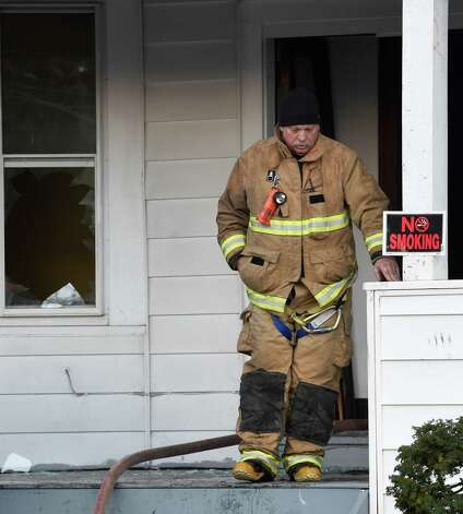 An Albany Fire Department investigator leaves the scene of fire that has been labeled suspicious at the offices of RISSE at 240 W. Lawrence early Tuesday morning Dec. 2, 2014 in Albany, N.Y.         (Skip Dickstein/Times Union) Photo: SKIP DICKSTEIN