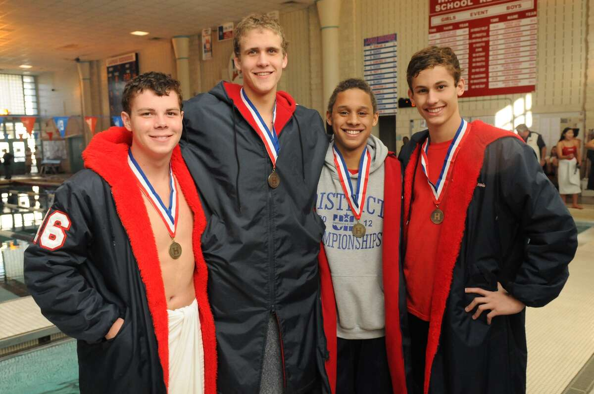 Lamar High School's Thomas Norman, from left, a senior, Jack Lyons, a senior, Safa Anya, a sophomore, and Alan Bourgeois, a junior, show off their gold medals after winning the Boys 4x50 Yard Medley Relay during the 2013 District 20-5A Swimming and Diving Championships at Lamar High School. Freelance photo by Jerry Baker