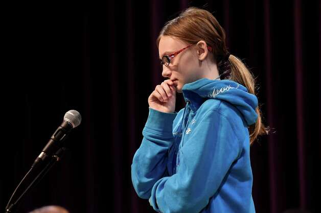 Kylie Reardon, 6th grade, representing Troy Middle School, is stumped for her response during the annual district-wide regional spelling bee competition Tuesday morning, Dec. 2, 2014, at Troy Middle School in Troy, N.Y. Students competed for a spot at the regional spelling bee at Proctors Theater in the spring of 2015.  (Skip Dickstein/Times Union) Photo: SKIP DICKSTEIN / 00029686A