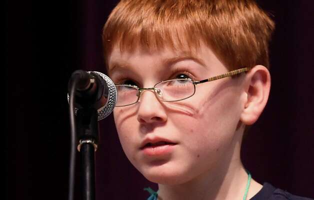 Tyler Giroux, 7th grade,  representing Troy Middle School, searches  for his response during the Ninth Annual Spelling Bee competition at the Troy Middle School Tuesday Dec. 2, 2014 in Troy, N.Y.       (Skip Dickstein/Times Union) Photo: SKIP DICKSTEIN / 00029686A