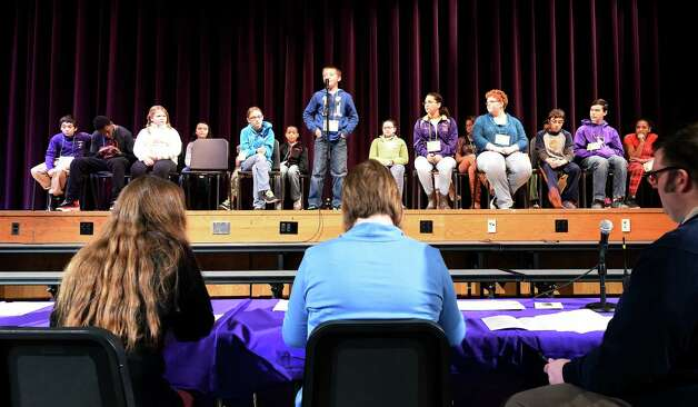 Judges listen carefully to responses by contestants in the annual district-wide regional spelling bee competition Tuesday morning, Dec. 2, 2014, at Troy Middle School in Troy, N.Y. Students competed for a spot at the regional spelling bee at Proctors Theater in the spring of 2015.  (Skip Dickstein/Times Union) Photo: SKIP DICKSTEIN / 00029686A