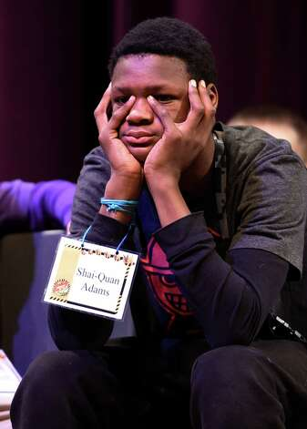 Shai-Quan Adams, 8 grade, representing Troy Middle School, waits his turn during the annual district-wide regional spelling bee competition Tuesday morning, Dec. 2, 2014, at Troy Middle School in Troy, N.Y. Students competed for a spot at the regional spelling bee at Proctors Theater in the spring of 2015.  (Skip Dickstein/Times Union) Photo: SKIP DICKSTEIN / 00029686A