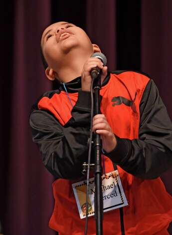 Michael Merced, 5th grade, representing Carroll Hill School, searches the sky for his response during the annual district-wide regional spelling bee competition Tuesday morning, Dec. 2, 2014, at Troy Middle School in Troy, N.Y. Students competed for a spot at the regional spelling bee at Proctors Theater in the spring of 2015.  (Skip Dickstein/Times Union) Photo: SKIP DICKSTEIN / 00029686A