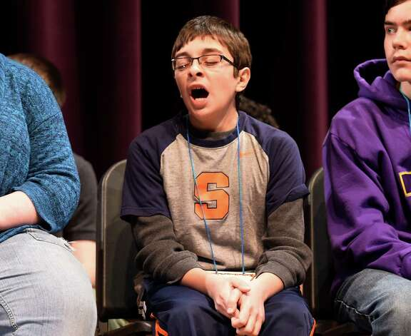 Jake Adams, 5th grade, representing School 18, yawns during the annual district-wide regional spelling bee competition Tuesday morning, Dec. 2, 2014, at Troy Middle School in Troy, N.Y. Students competed for a spot at the regional spelling bee at Proctors Theater in the spring of 2015. Adams won the event. (Skip Dickstein/Times Union) Photo: SKIP DICKSTEIN / 00029686A