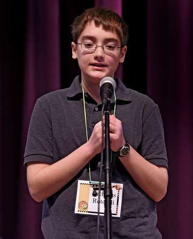 Nicholas Rotondi, 5th grade, representing School 18, looks for his response during the annual district-wide regional spelling bee competition Tuesday morning, Dec. 2, 2014, at Troy Middle School in Troy, N.Y. Students competed for a spot at the regional spelling bee at Proctors Theater in the spring of 2015.  (Skip Dickstein/Times Union) Photo: SKIP DICKSTEIN / 00029686A