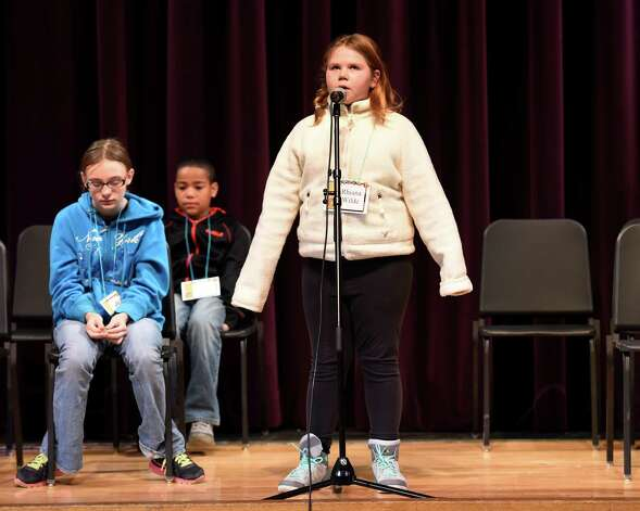 Rhiana Wilde, 5th grade, representing School 14 recites her response during the annual district-wide regional spelling bee competition Tuesday morning, Dec. 2, 2014, at Troy Middle School in Troy, N.Y. Students competed for a spot at the regional spelling bee at Proctors Theater in the spring of 2015.  Rhiana was runner-up in this competition. (Skip Dickstein/Times Union) Photo: SKIP DICKSTEIN / 00029686A