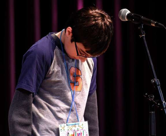 Jake Adams, 5th grade, representing School 18, bows his head before giving his winning response during the annual district-wide regional spelling bee competition Tuesday morning, Dec. 2, 2014, at Troy Middle School in Troy, N.Y. Students competed for a spot at the regional spelling bee at Proctors Theater in the spring of 2015.  (Skip Dickstein/Times Union) Photo: SKIP DICKSTEIN / 00029686A