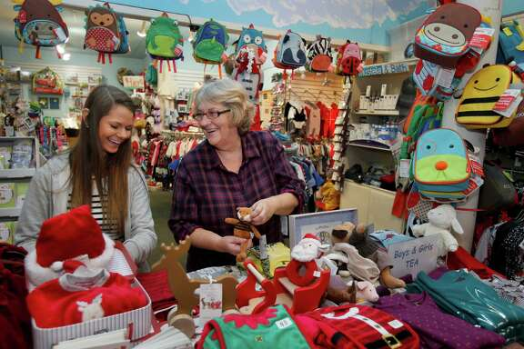 Carol Yenne (right) and Sophia Abrams enjoy a light moment in Small Frys Tuesday December 2, 2014. A San Francisco, Calif. store on 24th Street that has been shuttered for 11 years will soon be the site of a new retail venture thanks in part to Carol Yenne who owns a store up the street.
