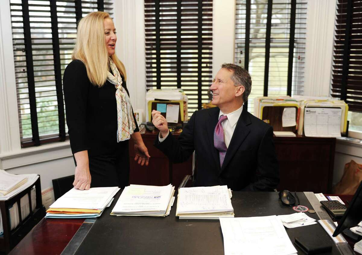 Allied Property Group Senior Sales Associate Diane Roth and Managing Partner Thomas Torelli chat in Torelli's office inside the Allied Property Group building in Greenwich, Conn. Tuesday, Dec. 2, 2014.