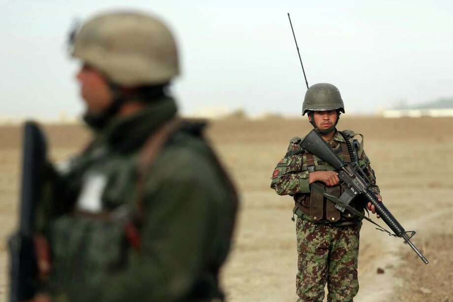In this file photo, Afghanistan national army soldiers stand guard in the Yahyakhail district of Paktika province east of Kabul, Afghanistan. Is U.S. mission creep threatening to keep our troops in Afghanistan indefinitely? Photo: Rahmat Gul / Rahmat Gul / Associated Press / AP