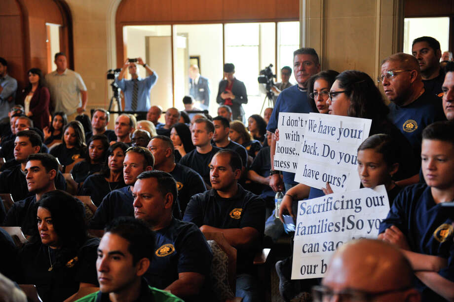 Unlike Scott Walker, City Manager Sheryl Scully hasn't equated battling police and firefighters unions with fighting ISIS. Union members fill the City Council Chamber during a council budget meeting. Photo: Robin Jerstad /For The Express-News / San Antonio Express-News