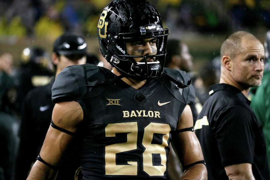 Baylor running back Devin Chafin (28) walks through the team bench area watching play against Oklahoma State during an NCAA college football game, Saturday, Nov. 22, 2014, in Waco, Texas. (AP Photo/Tony Gutierrez) Photo: Tony Gutierrez, Associated Press / AP