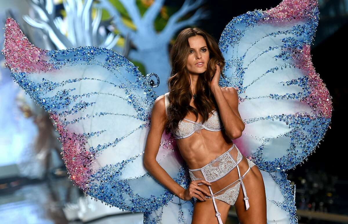 Model Izabel Goulart walks the runway during the 2014 Victoria's Secret Fashion Show at Earl's Court Exhibition Centre on December 2, 2014 in London, England.