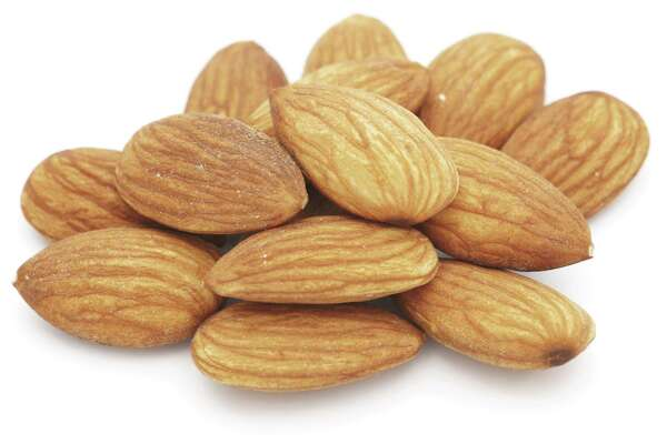 Almonds isolated on white - closeup
