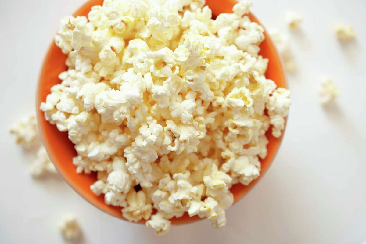 Low-fat popcorn This low-calorie snack will satisfy your craving for something salty and crunchy, and it's also a good source of fiber, De Fazio says.