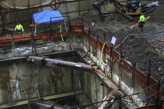Construction on the retrieval shaft continues to access the tunnel-boring machines below the old Pagoda Palace Theater.