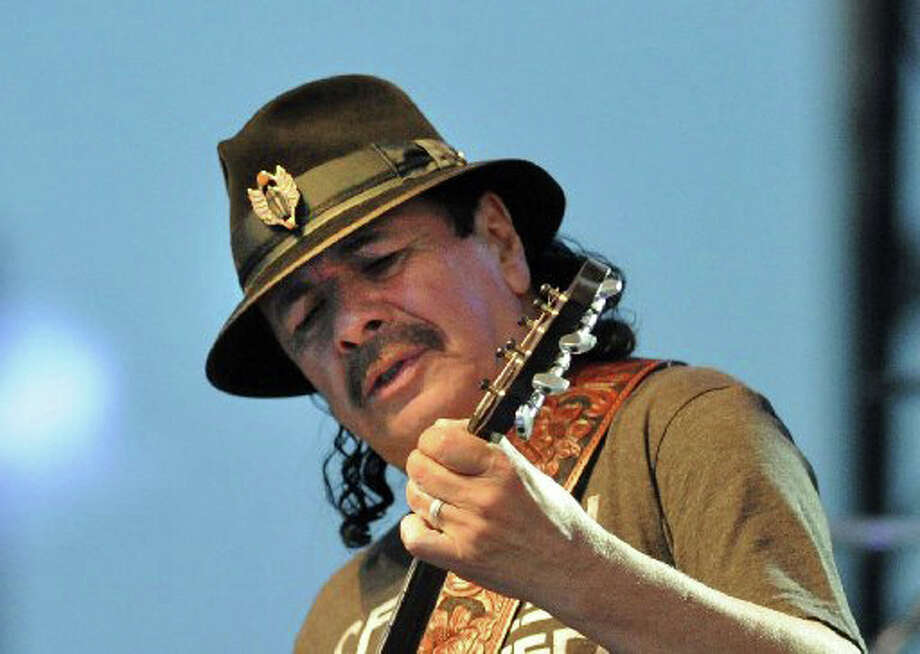 Carlos Santana performs during the Greenwich Town Party at Roger Sherman Baldwin Park, Greenwich, Conn., Saturday, May 24, 2014. Photo: File Photo / Greenwich Time File Photo