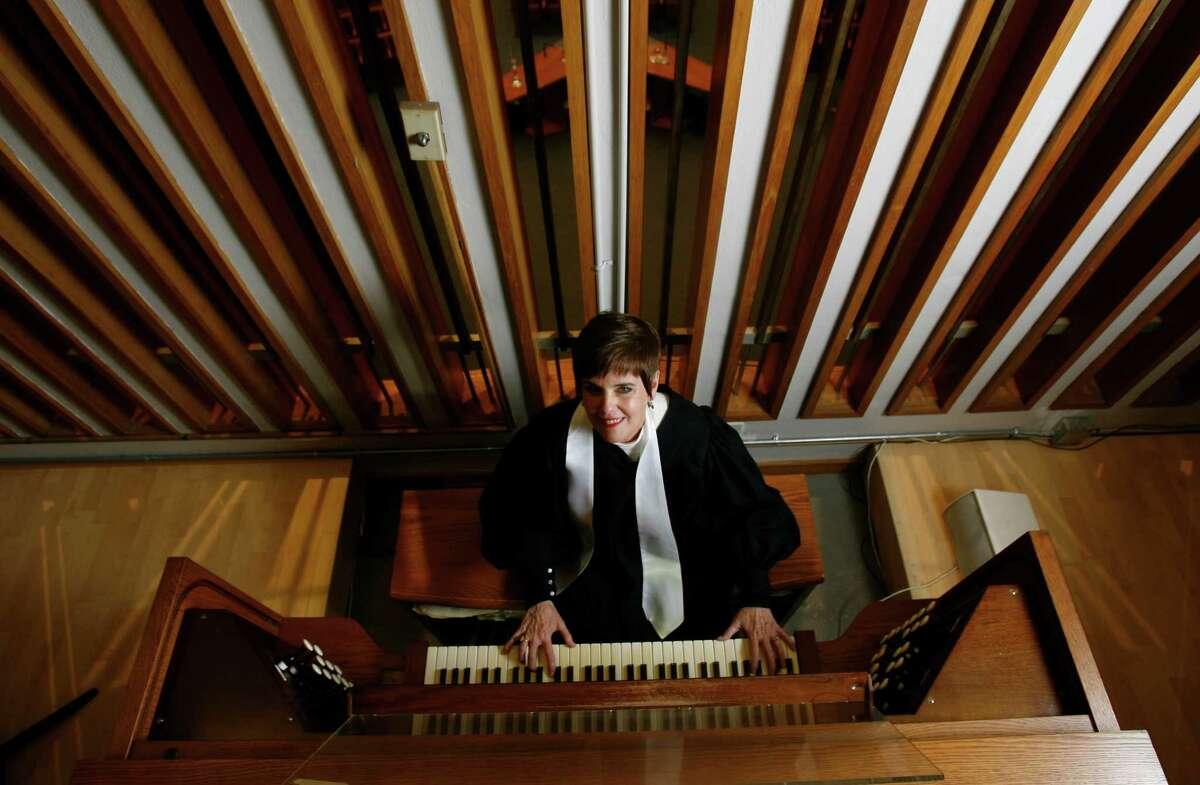 Ann Frohbieter at the organ of Temple Emanu El.